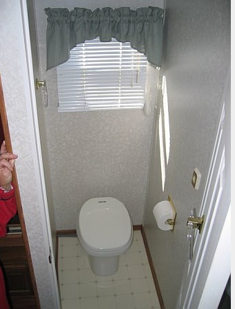 A room just for the potty, and with a solid door to boot; what luxury!