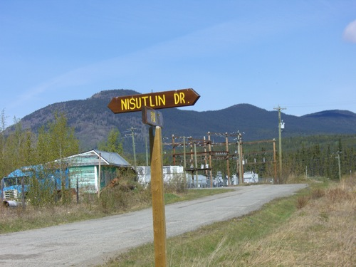 all street signs are wooden and painted