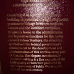 plaque about the history of the Territorial Administration Building and its architectural style (typical of the era)
