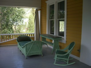 wicker furniture on the upstairs porch