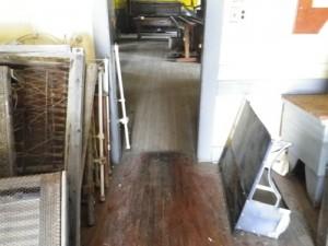 the floors in the messhall undulate like fields of prairie wheat