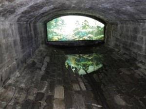 the old sewer system with a photograph showing what the exit would have looked like