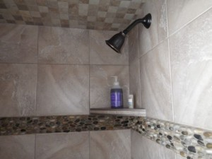 shower stall with gorgeous natural stone