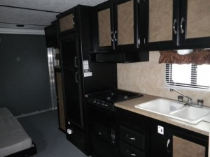 I had to take a picture of the interior of this toy hauler: IT IS THE UGLIEST RV I HAVE EVER SEEN!!!