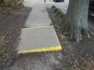 rather than fix sidewalks, Cape Charles paints the obstacles vivid yellow