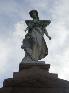One of the many beautiful statues in a Catholic cemetery.