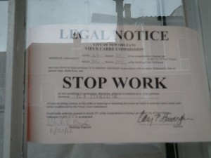 Legal notice to stop renovations. Tourists know this area as the 'French Quarter' but it is officially the 'Vieux Carré' (old square).