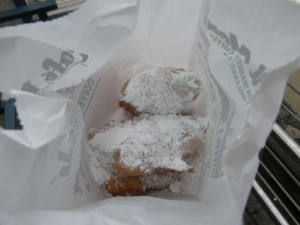 You get three beignets (puffy deep fried bits of dough covered in powered sugar) for $2 and change. One would have been enough for me! They are also famous for their chicory café au lait.