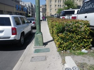 Lots of lampposts right in the middle of the sidewalk. Odd.