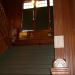 a grand old staircase; typical of the government building architecture in Dawson in the early 20th century